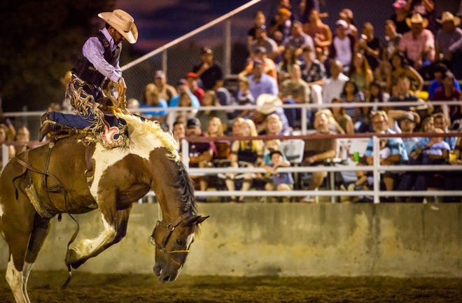 Luis Aguirre, who won the saddle bronc event, stays on his horse at the Bastrop Rodeo on August 3, 2019. This year's Homecoming and Rodeo runs Aug. 4-7.
