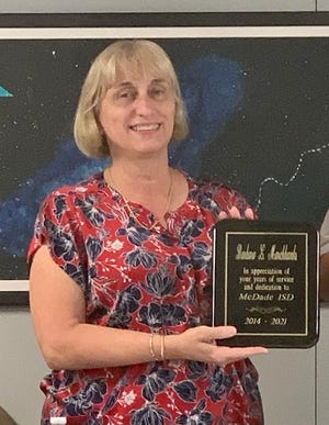 The McDade school board presented Superintendent Barbara Marchbanks with a plaque in appreciation of her seven years of service.