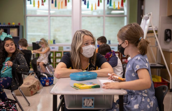 First-grade teacher Jessica Dever is shown last year talking to Sarah Single, then 6, on the first day of school at Rough Hollow Elementary School in Spicewood.
