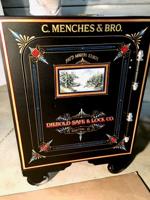 A restored 1877 safe, built by Diebold in Canton, will return to the Menches family.