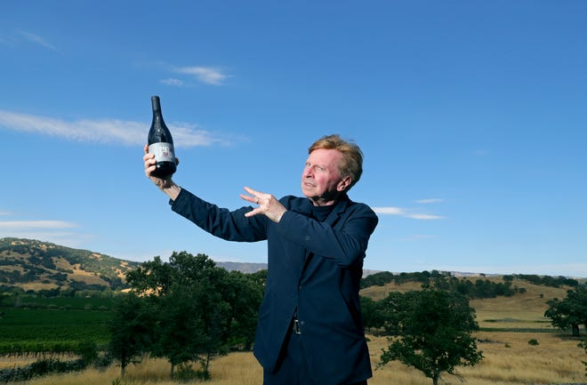 Devo rocker and Northeast Ohio native Gerald Casale shows off The 50 by 50 Pinot Noir at his Monticello Road ranch in Napa, California. He hopes to make Bordeaux-style wines.