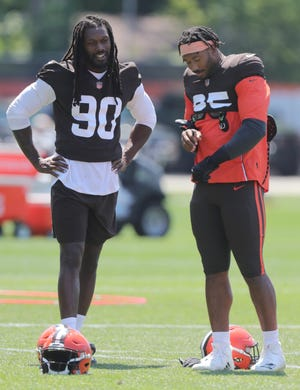 Browns defensive ends Jadeveon Clowney and Myles Garrett, shown during training camp, both returned to practice Thursday and the two former No. 1 overall draft picks should be in the lineup to face former No. 1 draft pick and Arizona Cardinals quarterback Kyler Murray.  [Phil Masturzo/ Beacon Journal]