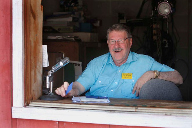 Jeff Eble celebrates 50 years of being the announcer for the Medina County Fair on Wednesday in Medina.