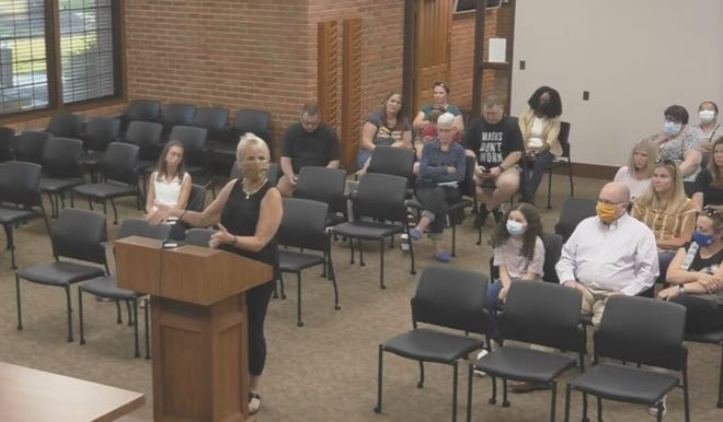 Jill Zupon asks the school board if the district could work with transportation companies to provide busing for special needs students in the district who are attending non-public schools. Several residents came to the school board's Aug. 4 meeting.