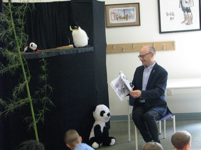 Eric Taggart, director of Rodman Public Library, takes part in a children's Storytime program July 22, 2021, at the library. Taggart was recently elected to two state advisory boards.
