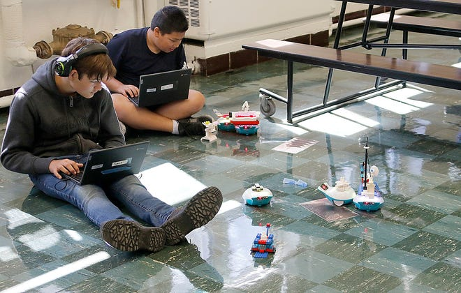 Keagen Stanly Schnell and Landon Erandilo try to protect their lairs from the other monster bots during the battle at Hillsdale Middle School's summer school Thursday, Aug. 5, 2021. TOM E. PUSKAR/TIMES-GAZETTE.COM