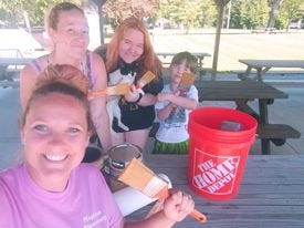 Polk residents who stained Jackson Township Community Park picnic tables recently, included, from left, Cynthia Cornett, Ada, Grace and Caleb Conley and Jessica Burget (not pictured).