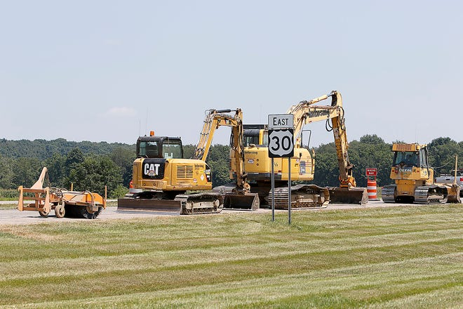 Equipment sits on the side of the road on US 30 during the construction at the intersection of state Route 89 on Thursday, Aug. 5, 2021. TOM E. PUSKAR/TIMES-GAZETTE.COM