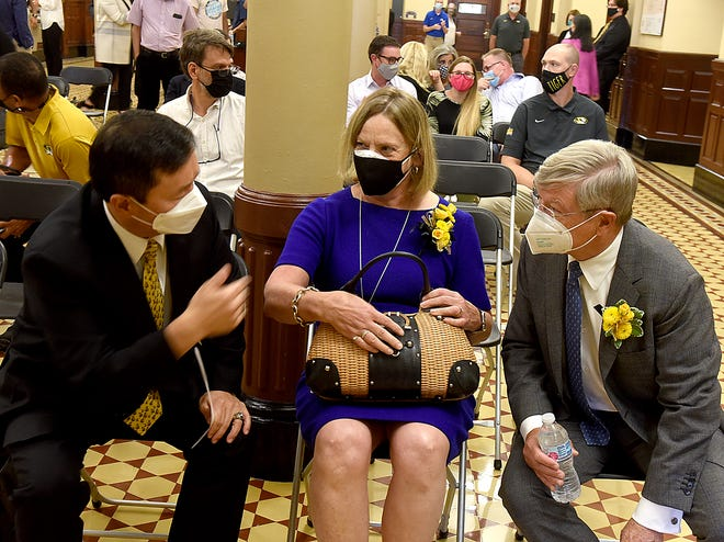 """University of Missouri System President Mun Choi, left, talks with Pinney Allen and her husband, Charles """"Buddy"""" Miller III, prior to the announcement of their financial gift to the Trulaske College of Business on Thursday at Jesse Hall."""