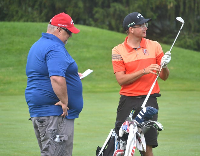 Cheboygan golfer PJ Maybank III, right, talks things over with his father, Pete, during the MHSAA Division III golf state finals at Grand Valley State University in June. On Wednesday, Maybank verbally committed to play men's golf for the University of Oklahoma Sooners.