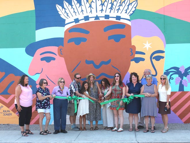 Leaders from the Once Again Shoppe, the Village of Penn Yan, Yates County, and the Chamber of Commerce participated in the ribbon cutting to officially present the new mural to the public.