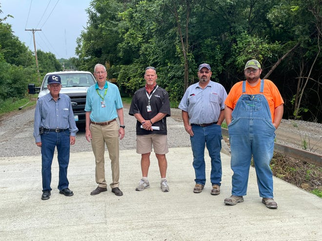 Earlier this week a 26 foot long bridge opened on LIV 429 in Utica.  Pictured in the bridge are County Commissioners and the bridge crew.