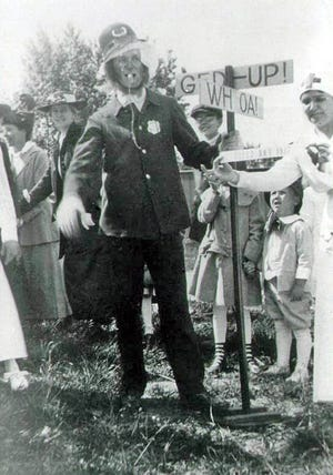 Rev. Oliver C. Weist, pastor of First Community Church in Marble Cliff, is dressed as a Keystone Cop for the tri-village Field Day celebration in 1917.