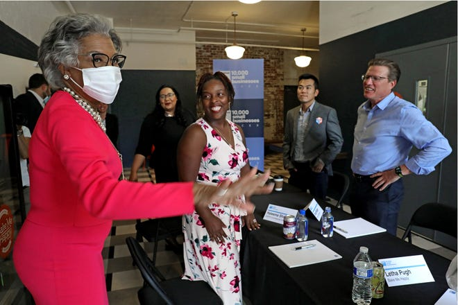 Congresswoman Joyce Beatty, far left, arrives at Bake Me Happy to join Columbus-area small business owners for a roundtable discussion on the challenges they still face amid the pandemic, including access to capital. The event is part of the Goldman Sachs 10,000 Small Businesses Voices initiative. From left, are Beatty, Lisa Gutierrez of Dos Hermanos, Haleema Shafeek of GOFS Commercial Interiors, Michael Cao of IC3D and Greg Manger of Costume Specialists.