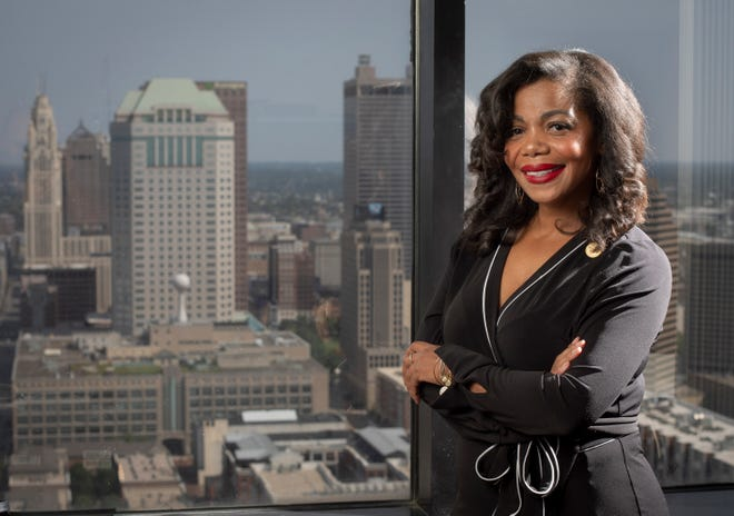 Former state Rep. Erica Crawley, who became a Franklin County commissioner on July 1, stands her in new office in the Franklin County Government Center.