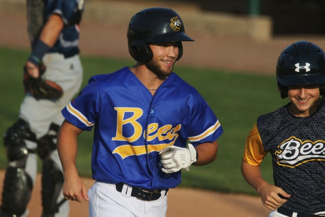 Burlington Bees Sam Monroe (2) smiles as he heads back to the dugout after scoring a run during the final game of the season against the Quincy Gems Wednesday Aug. 4, 2021, at Community Field.