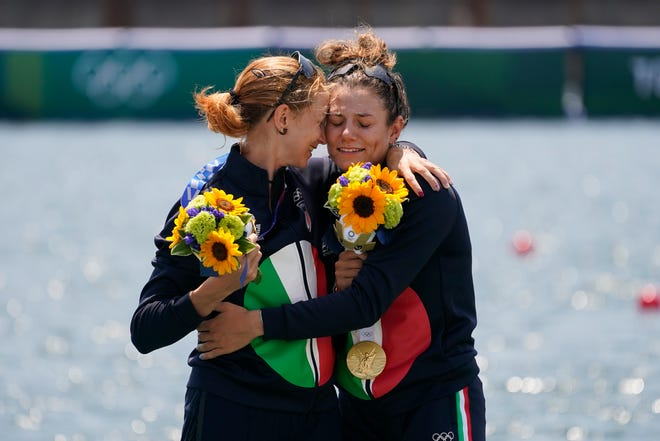 Valentina Rodini and Federica Cesarini of Italy pose with the gold medal in the lightweight women's double sculls final at the 2020 Summer Olympics, Thursday, July 29, 2021, in Tokyo, Japan.