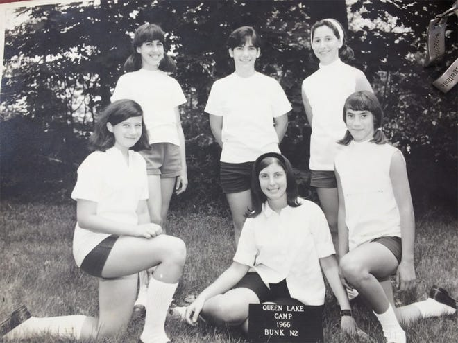 Ann Kent Cowen, shown seated at center in 1966, was a favorite counselor among the girls who attended Queen Lake Camp in Phillipston.