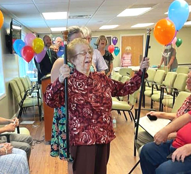 Rita Tkaczyk, the new recipient of Templeton's historic Boston Post Cane, displays the original cane as well as a replica she received recently as the oldest resident of the town of Templeton. Tkaczyk turned 100 in May.