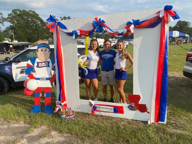 A trio of DeRidder Dragons were all smiles at National Night Out 2021