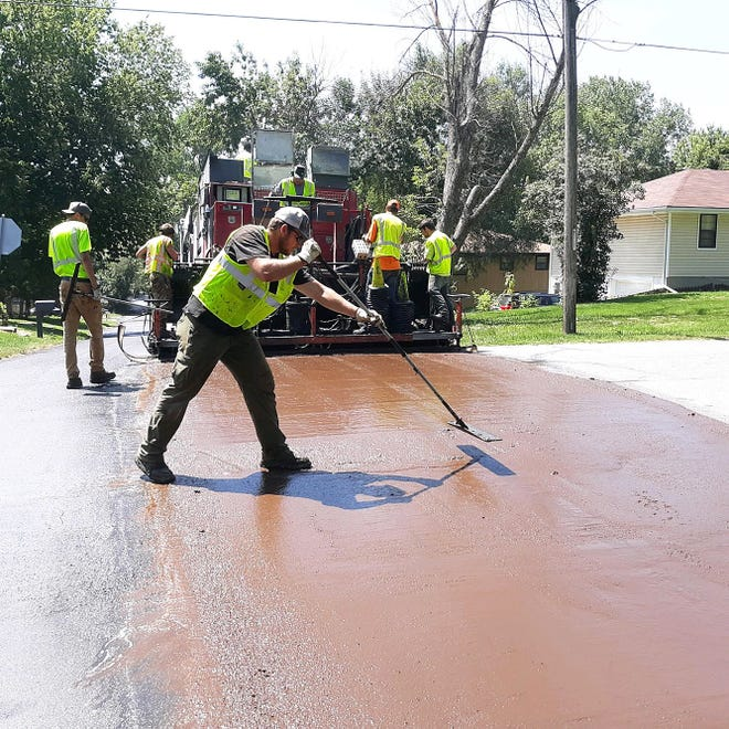 Crews work to resurface pavement on Cleveland Terrace in Leavenworth recently when the temperature soared to 100 degrees.