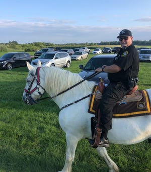 Hank, an 18-year-old Percheron horse and member of the Monroe County Sheriff's Posse, passed away this week following an illness. Here he is while on patrol with his owner, Mounted Division Reserve Deputy Mike Humphries.