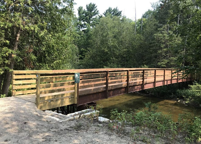 This new pedestrian bridge provides a trail link between Petoskey's River Road Sports Complex and the North Central Michigan College natural area.