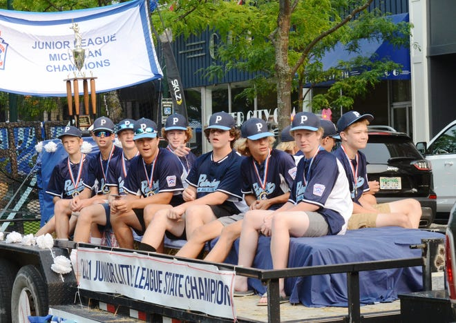 The Petoskey Junior All-Star players take in the celebration down Mitchell Street in Petoskey Wednesday after their 2021 Junior Little League State Championship.