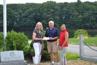 Joann Neumann, Development Director, Families First; Michael Griffin, Exalted Ruler, Portsmouth Lodge #97; and Elyse Gallo. Grant Coordinator, Portsmouth Lodge #9 celebrate the Elks' donation to Families First.