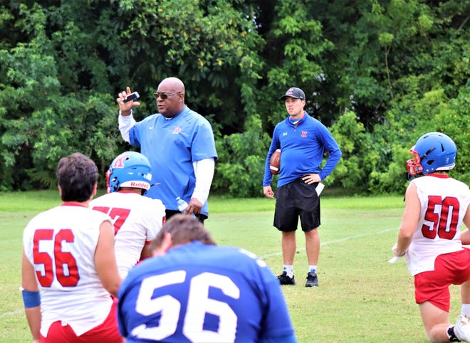King's head coach Ronnie Lee (left) gives notes at a socially distanced huddle at the conclusion of camp.