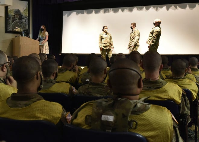 From left: Staff Sgt. Keyle Reyes and Spcs. Lauren Doyle and William Wiggs from the 787th Military Police Battalion perform a skit on sexual harassment during Sexual Harassment and Assault Response Prevention training Friday in the auditorium of the 43rd Adjutant General Battalion. The 14th Military Police Brigade has worked to improve SHARP training provided during reception to ensure the Army's newest Soldiers in training understand the program's policies and procedures. Brian Hill, Fort Leonard Wood Public Affairs Office
