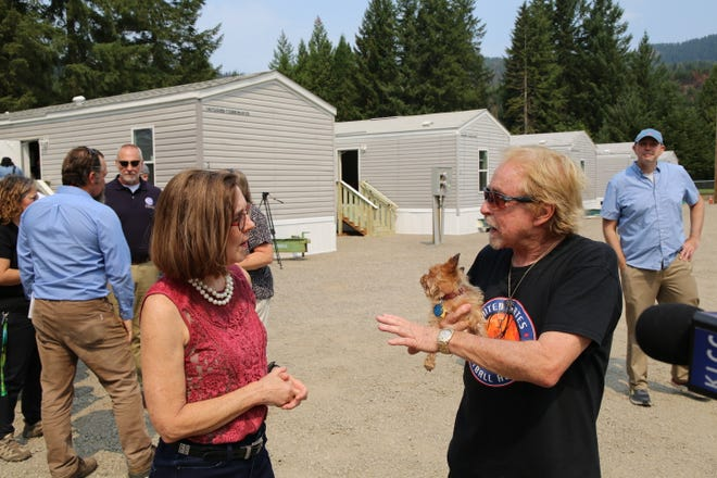 Gov. Kate Brown visits with a Blue River community member Thursday, Aug. 5, 2021, as she reviews areas damaged by the 2020 Holiday Farm Fire.