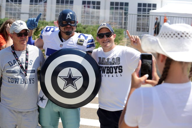 Eric Welborn, aka Captain America's Team, of Elkin, North Carolina, poses for a snapshot with Denny Clark, left, and his son Danny Clark of State College, Pennsylvania, at Thursday's Pro Football Hall of Fame Fun Fest.