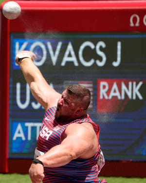 Joe Kovacs, of United States, silver, competes in the final of the men's shot put at the 2020 Summer Olympics, Thursday, Aug. 5, 2021, in Tokyo, Japan. (AP Photo/Charlie Riedel)