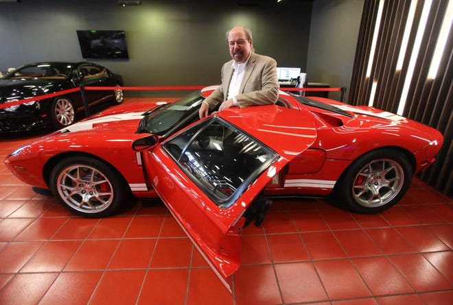 Stephen M. Saleen, a legend in the automotive industry, shows off the 2006 Ford GT he designed during an exclusive VIP party for the grand opening of Sarchione Auto Gallery, a luxury dealership in Jackson Township on Wednesday, August 4, 2021.