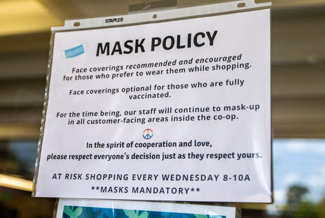 Purple Porch Co-Op's mask policy is posted at its entrance on Thursday in South Bend.