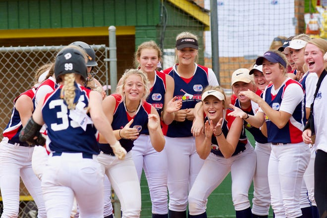 Davidson County Post 8 players prepare to congratulate a teammate after a home run Wednesday during the Lady Legion softball championship in Boiling Springs.