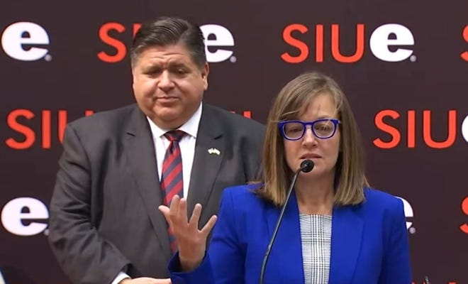 Rep. Katie Stuart, D-Edwardsville, and Gov. JB Pritzker speak at a news conference Thursday at which the governor signed three bills aiming to break down financial barriers to feminine hygiene products.