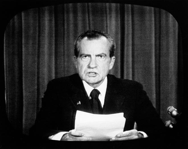 In this photo made from a television screen broadcasting an NBC Special Report, President Richard M. Nixon appears on national television on Aug. 8, 1974, to announce his resignation.