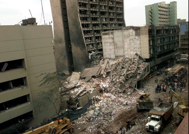 In this Aug. 8, 1998 photo, the remains of the U.S. Embassy and other damaged buildings in downtown Nairobi, Kenya are shown on the day after it was bombed by terrorists. The U.S. Embassy in Dar es Salaam, Tanzania, also was bombed.