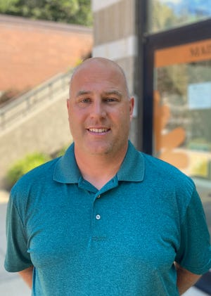 Mike Rasmussen was hired by Glen Oaks Community College as its new director of athletics.