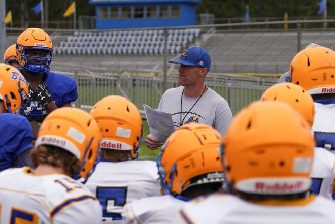 Coach Luke Little gives instructions at Laney football practice on Wednesday. After a shortened and postponed season last school year, Little hopes a full year will produce a rise in the standings for the Bucs in 2021. [KEN OOTS/FOR THE STARNEWS]