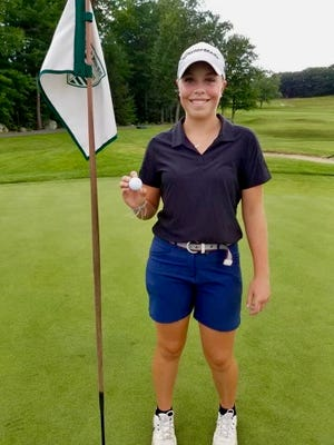 Oakmont Regional senior Mackenzie Whitney proudly displays the ball after her hole-in-one at Oak Hill.