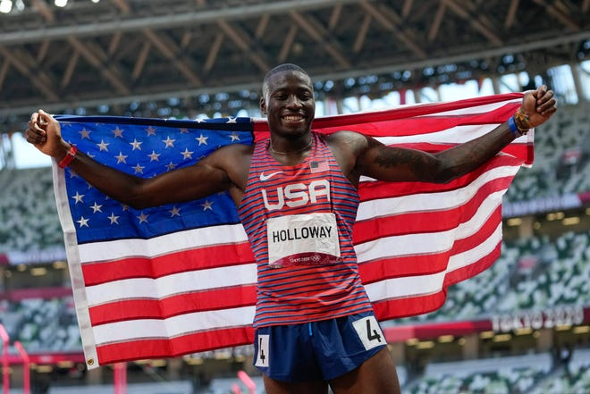 Grant Holloway, of the United States, celebrates after winning the silver medal in the men's 110-meter hurdles final at the 2020 Summer Olympics, Thursday, Aug. 5, 2021, in Tokyo, Japan. (AP Photo/Petr David Josek)