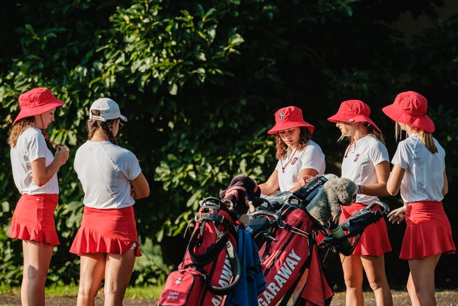 The Garaway High School Girls team chat shortly before the Inter-Valley Conference Girls Preseason Tournament Thursday, August 5 at Wilkshire Golf Course in Bolivar.
