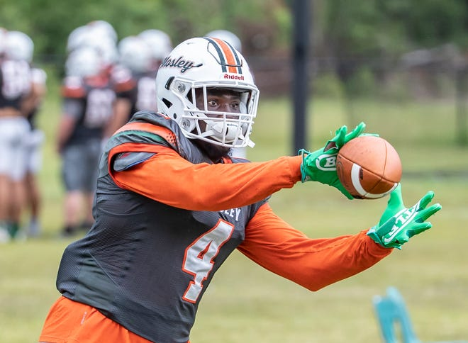 Mosley tight end Randy Pittman eyes the ball during practice Wednesday, Aug. 4, 2021.