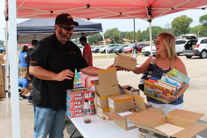 Volunteers distribute school supplies to Fort Smith teachers on Aug. 5 in the parking lot of Ramsey Middle School on 3201 Jenny Lind Road.