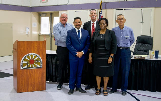 Christopher Nunez (second from left) was appointed to the Apple Valley Unified Board of Trustees during a special meeting on Thursday, July 29, 2021. Also pictured, from left, are AVUSD trustees Dennis Bender, Rick Roelle and Wilson So. Board President Maria Okpara is next to Nunez.