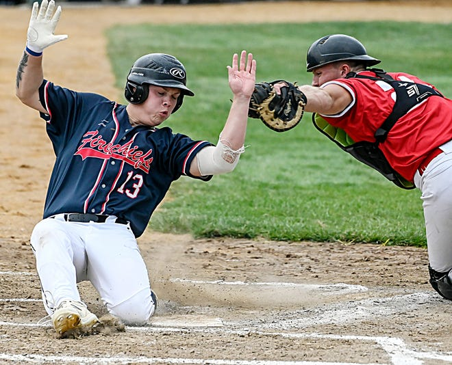 Milbank's Dominique Boerger (left) beats the tag attempt by Platte's Hunter Hewitt scoring during their first-round game Wednesday in the state Class B amateur baseball tournament at Cadwell Park in Mitchell. Milbank won 8-4.