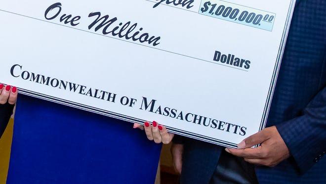 Vaxmillions giant check for $1 million.